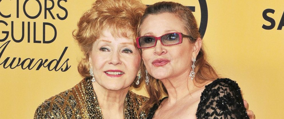 PHOTO: Debbie Reynolds and her daughter, Carrie Fisher pose in the press room at the 21st annual Screen Actors Guild Awards at The Shrine Auditorium in Los Angeles, Calif.,January 25, 2015.