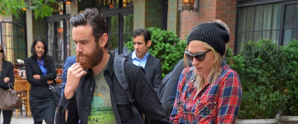 PHOTO: Ke$ha and boyfriend Brad Ashenfelter hold hands as they head out of a New York City hotel on May 28, 2014.