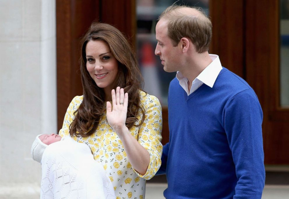 PHOTO: Catherine, Duchess of Cambridge and Prince William, Duke of Cambridge depart the Lindo Wing with their newborn daughter, Princess Charlotte, at St Marys Hospital on May 2, 2015 in London.