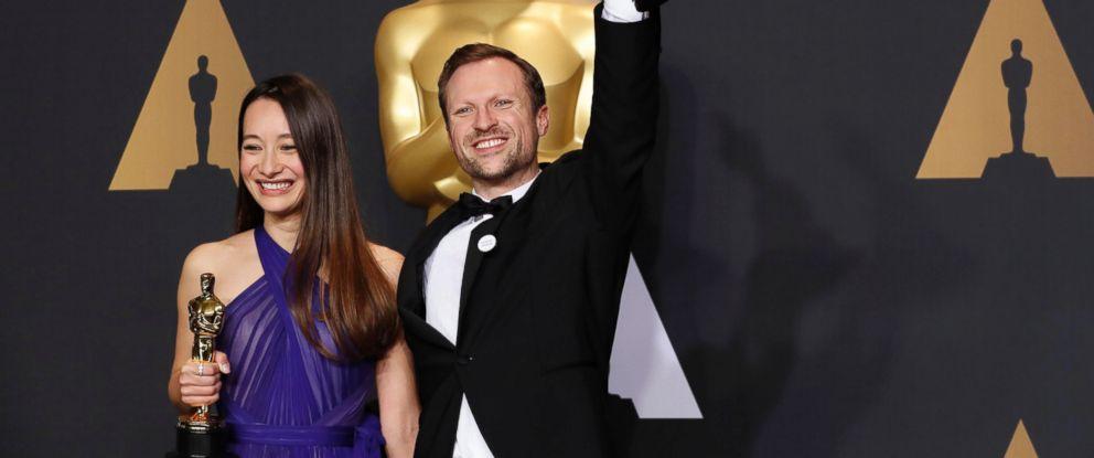 "PHOTO: Orlando von Einsiedel and Joanna Natasegara hold their Oscars for Best Documentary Short Subject for ""The White Helmets."""