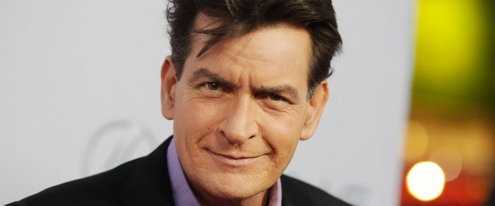 """PHOTO: Cast member Charlie Sheen poses at the premiere of his new film """"Scary Movie 5"""" in Hollywood, Calif. on April 11, 2013."""