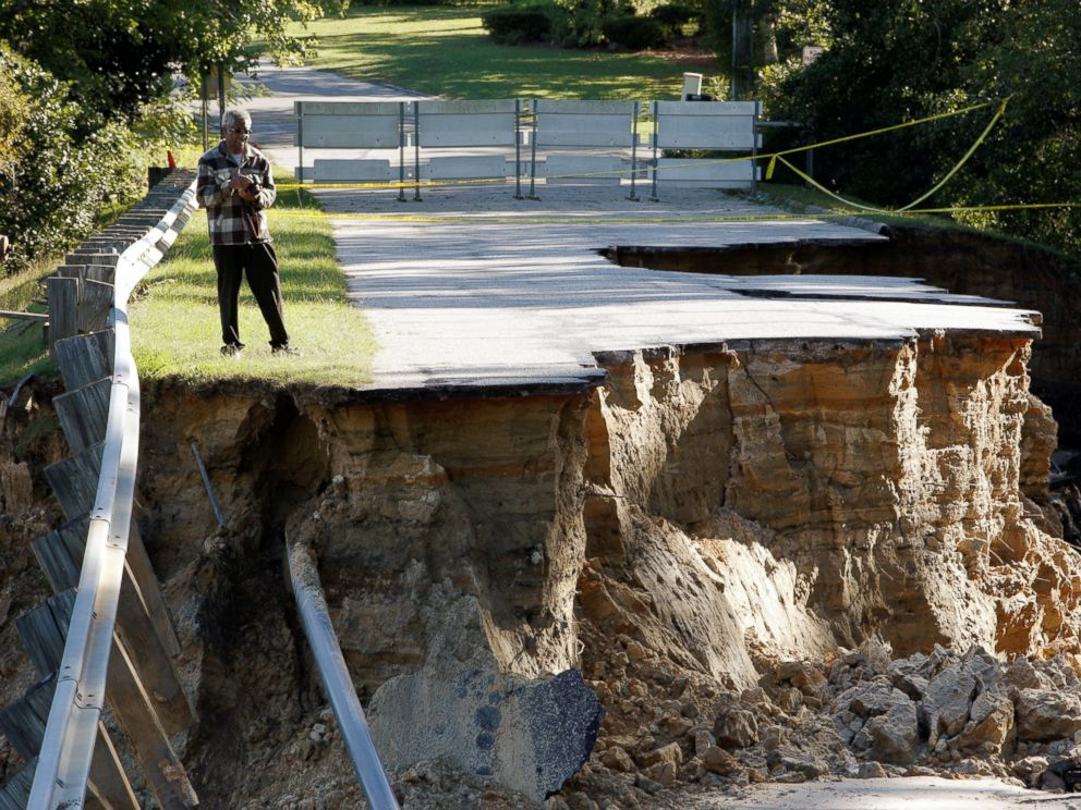 PHOTO: A resident surveys the scene of a washed out road after Hurricane Matthew struck the state, in Fayetteville, North Carolina, Oct. 10, 2016.