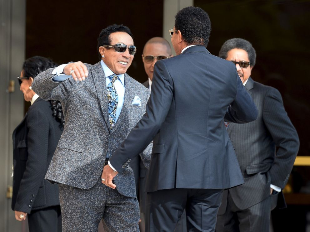 PHOTO: Smokey Robinson hugs Lionel Richie as they arrive for a funeral service for singer Natalie Cole in Los Angeles, Jan. 11, 2016.