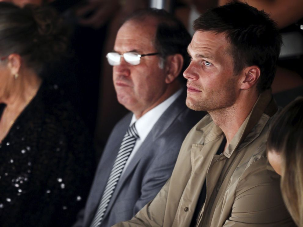 PHOTO: NFL player Tom Brady watches his wife model Gisele Bundchen as she presents creations for the Colcci Summer 2016 collection during Sao Paulo Fashion Week in Sao Paulo April 15, 2015.