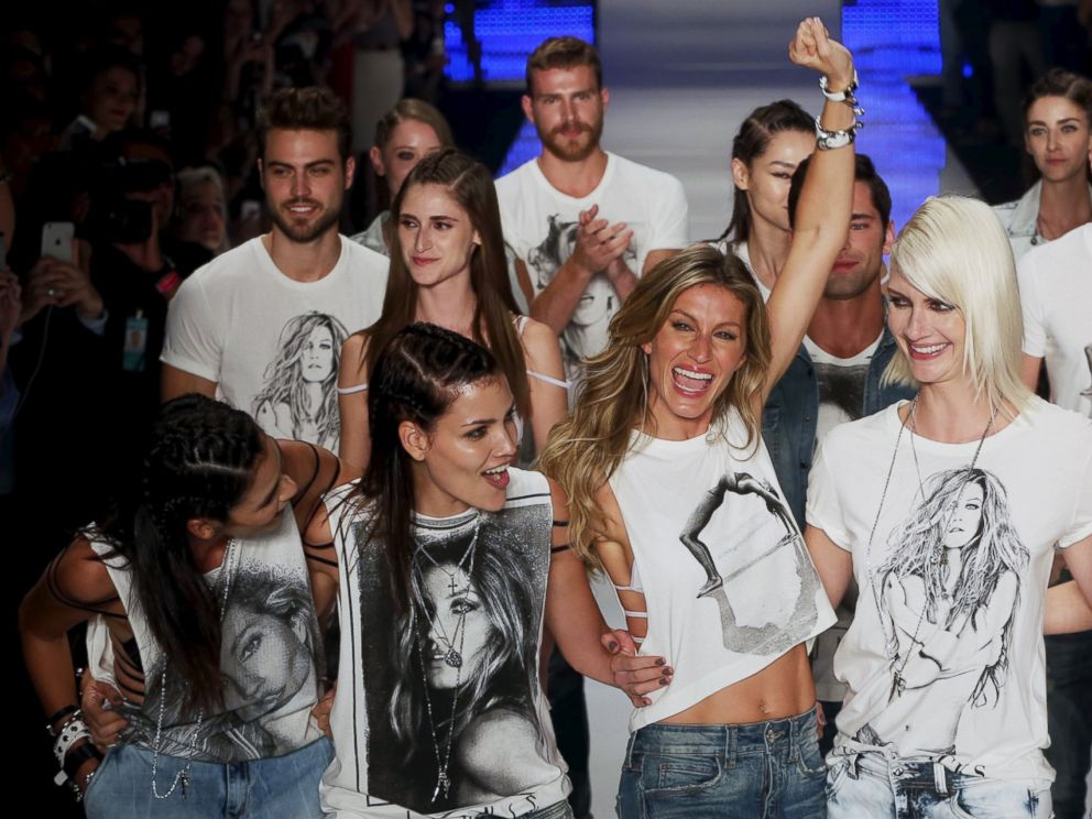 PHOTO: Model Gisele Bundchen reacts as she and other models present creations from the Colcci Summer 2016 collection during Sao Paulo Fashion Week in Sao Paulo, Brazil, April 15, 2015.