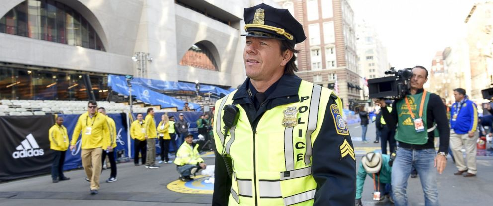 """PHOTO: Mark Wahlberg in the role of a Boston police officer prepares to film a scene for the movie """"Patriots Day"""" at the finish line before the start of the 120th running of the Boston Marathon in Boston, April 18, 2016."""