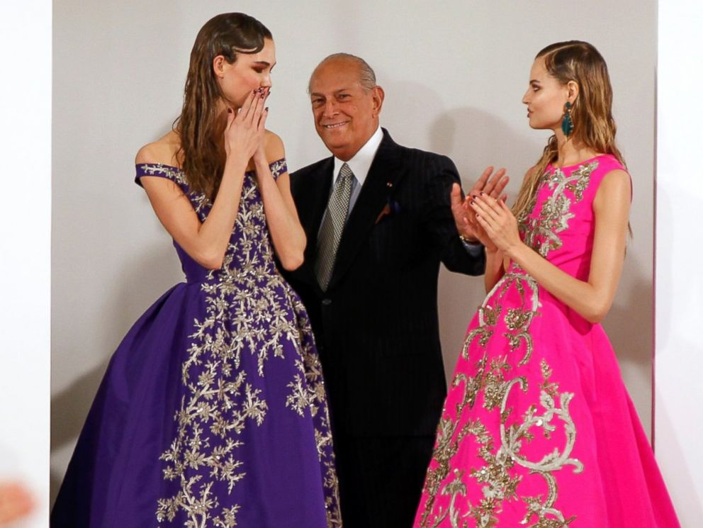 PHOTO: Designer Oscar De La Renta smiles with model Karlie Kloss and another model after presenting his Autumn/Winter 2013 collection during New York Fashion Week, Feb. 12, 2013.