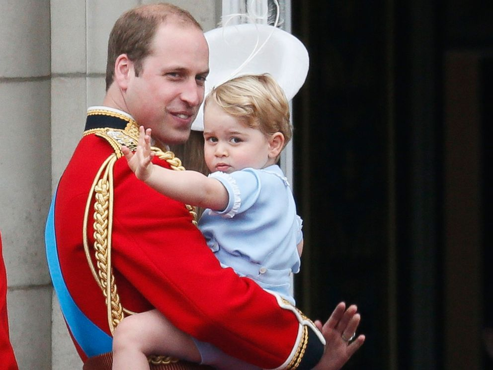 PHOTO: Britains Prince William holds Prince George as he waves from the balcony at Buckingham Palace after the Trooping The Color ceremony in central London, June 13, 2015.