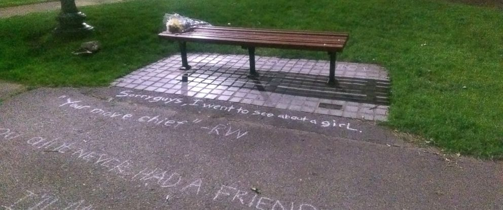 "PHOTO: Fans left flowers and wrote quotes in chalk on the sidewalk at a Boston bench seen in the 1997 movie ""Good Will Hunting"" following the death of actor Robin Williams, Aug. 11, 2014."