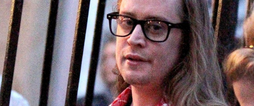 "PHOTO: Macaulay Culkin pictured standing outside on the fire escape stairs as he films scenes for ""The Jim Gaffigan Show"" in New York, March 13, 2016."