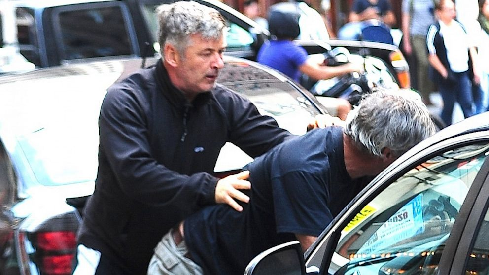 Alec Baldwin fights with a photographer over his wife in New York City, Aug. 27, 2013.