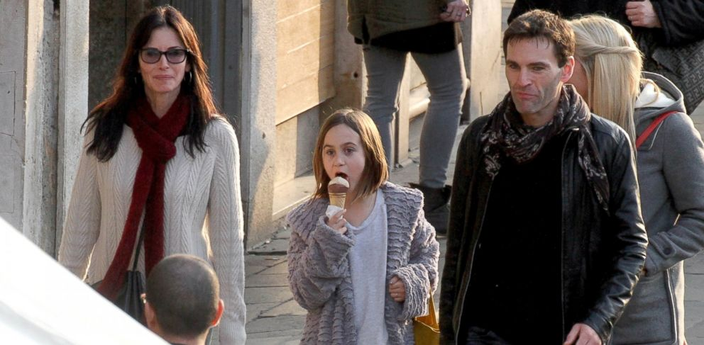 PHOTO: Courteney Cox, left, is pictured with her daughter Coco Arquette, center, and boyfriend Johnny McDaid, right, in Venice, Italy on Feb. 17, 2014.