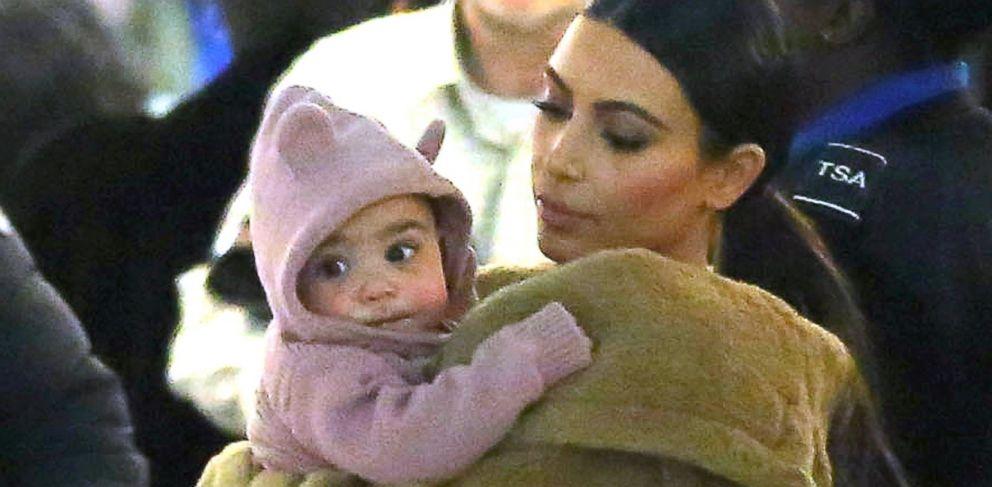 PHOTO: Kim Kardashian carries her baby North through John F. Kennedy International Airport on Feb. 25, 2014 in New York City.