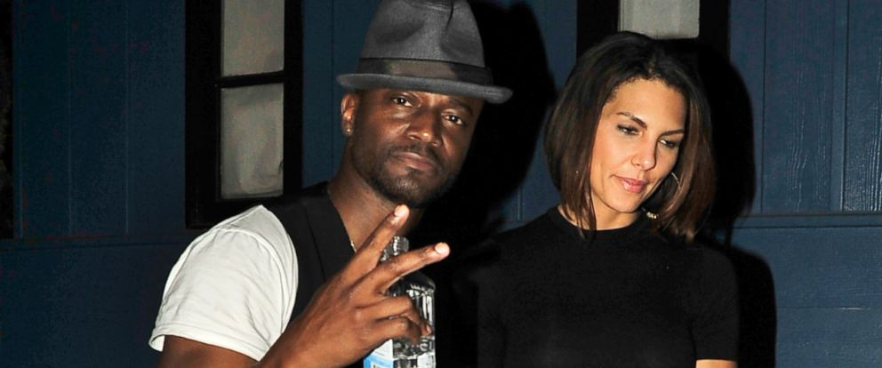 PHOTO: Taye Diggs and a friend leave Hooray Henrys Nightclub in West Hollywood, April 9, 2014.