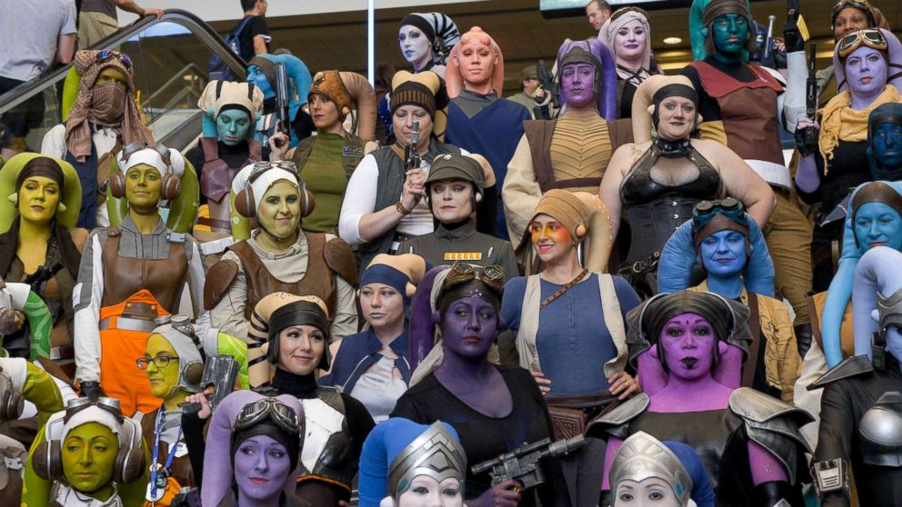 PHOTO: Women dressed as Star Wars species known as Twilek gather for a photo at Star Wars Celebration Orlando in 2017.