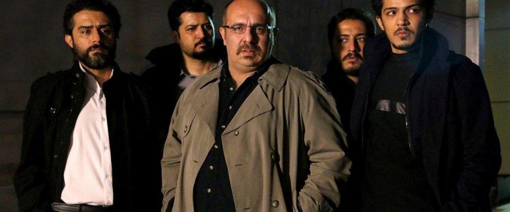 "This undated promotional handout still from the Iranian state TV series, ""Gando,"" shows actor Payam Dehkordi, center, who plays a character apparently based on Washington Post journalist Jason Rezaian, among other actors. The new Iranian television s"