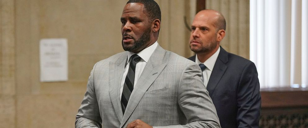 FILE - In this June 6, 2019, file photo, singer R. Kelly pleaded not guilty to 11 additional sex-related felonies during a court hearing before Judge Lawrence Flood at Leighton Criminal Court Building in Chicago. R. Kelly, already facing sexual abuse