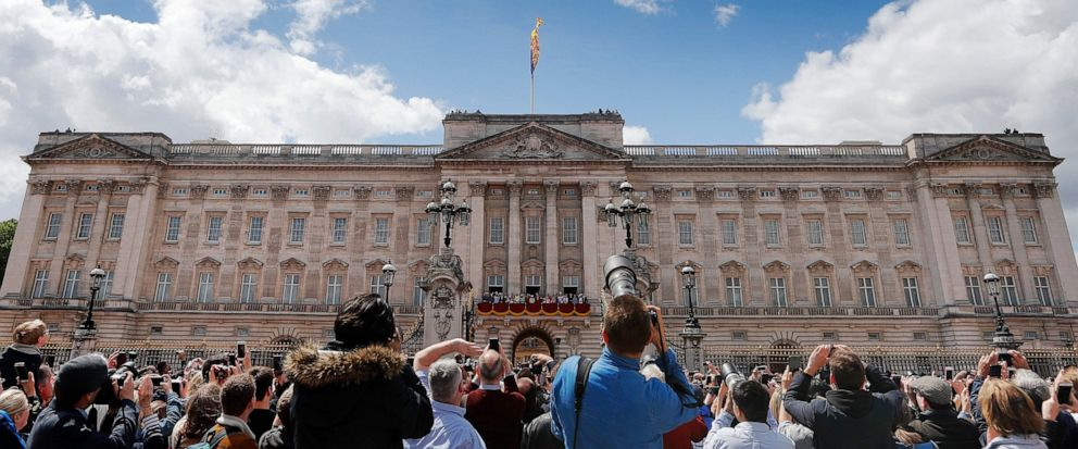FILE - In this Saturday, June 8, 2019 file photo, Red Arrows planes fly over Buckingham Palace during the annual Trooping the Colour Ceremony in London. London police have arrested a man who climbed the front gates of Buckingham Palace while Queen El