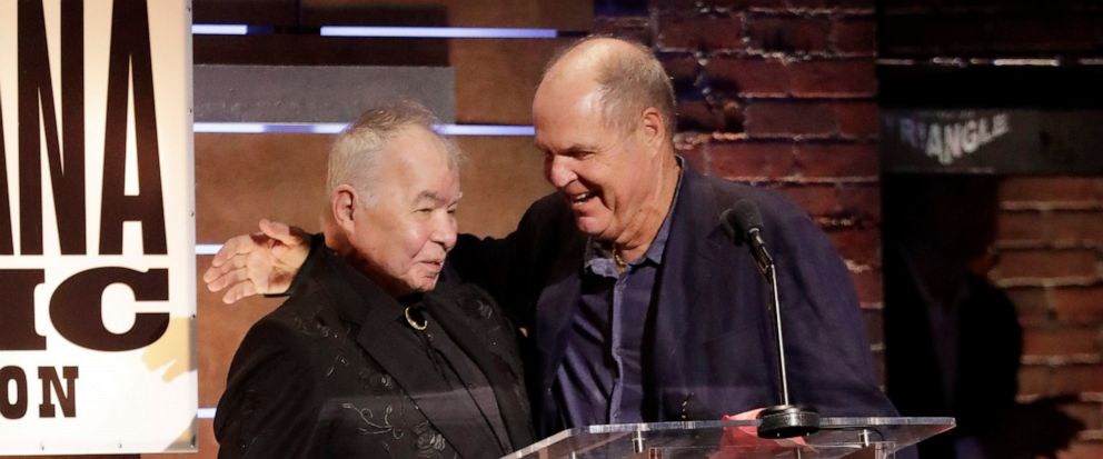 "John Prine, left, and Pat McLaughlin accept the Song of the Year Award for ""Summers End"" at the Americana Honors & Awards show Wednesday, Sept. 11, 2019, in Nashville, Tenn. (AP Photo/Wade Payne)"