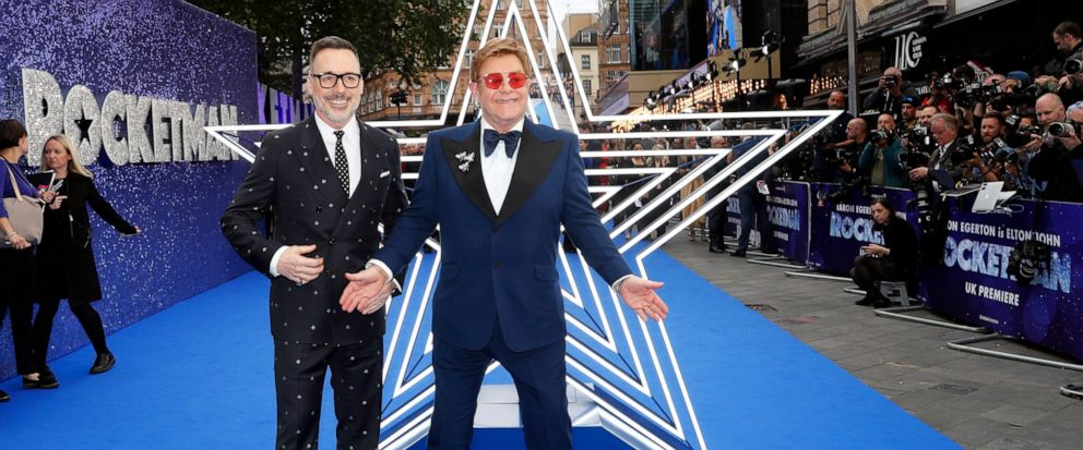 "FILE - In this May 20, 2019, file photo, musician Elton John and his husband producer David Furnish, left, arrive for the UK Film Premiere of Rocketman at the Odeon Luxe in London. The Pacific nation of Samoa has banned the Elton John biopic ""Rocketm"