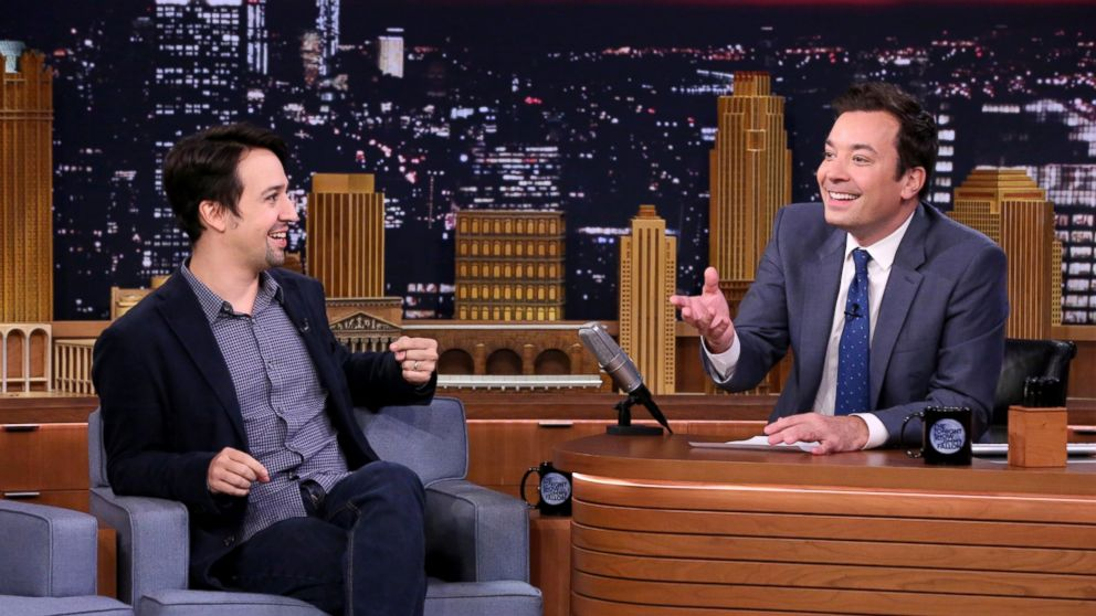"""This Oct. 4, 2016 image released by NBC shows Lin-Manuel Miranda during an interview with host Jimmy Fallon on """"The Tonight Show Starring Jimmy Fallon,"""" in New York. Fallon's """"Tonight Show"""" broadcast from Puerto Rico on Jan. 15, will showcase artists with ties to the U.S. territory. Besides previously announced Miranda, Fallon will be joined on the show by Jose Feliciano, Bad Bunny and Ozuna. (Andrew Lipovsky/NBCU Photo Bank via AP)"""