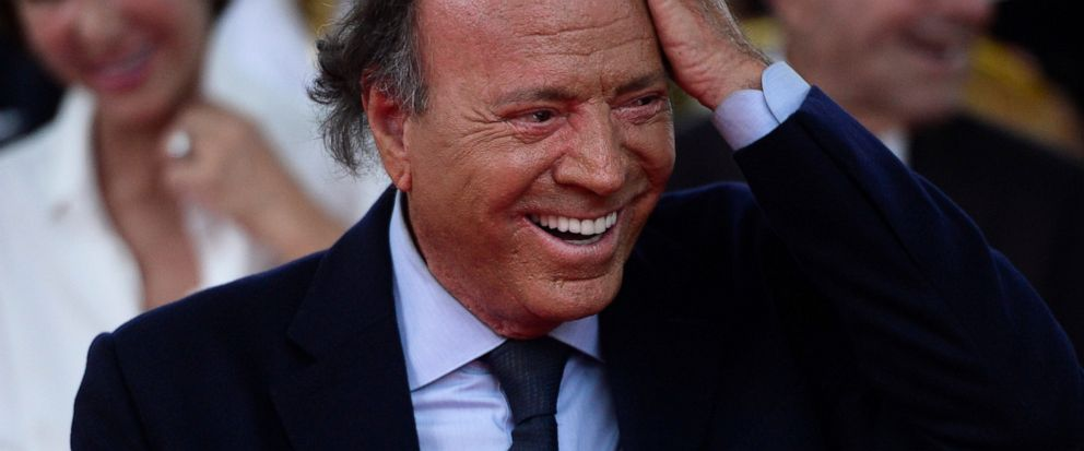 FILE - In this Sept. 29, 2016 file photo, Spains singer Julio Iglesias smiles during his star unveiling ceremony at the Walk of Fame in San Juan, Puerto Rico. At 75 and after a five-decade-long career, Julio Iglesias keeps performing internationally