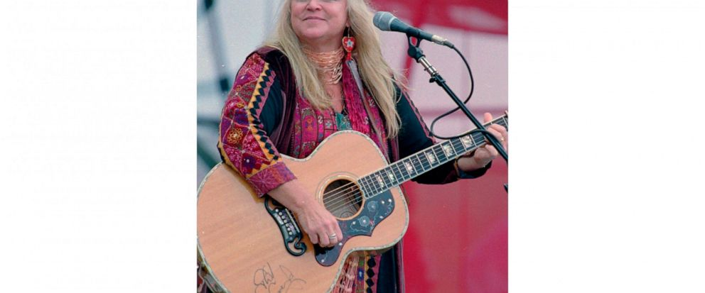 "FILE - In this Aug. 15, 1998, file photo, Melanie Safka, who performed at the original Woodstock decades ago, opens the second day of the festival ""Day In The Garden,"" in Bethel, N.Y. She was just 22 when she performed at the historic 1969 concert th"