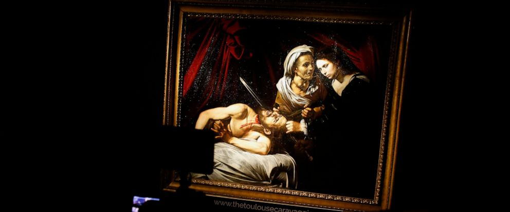 "The Caravaggio painting entitled ""Judith Beheading Holofernes"", is presented to the press, at the Drouot auction house in Paris, Friday, June 14, 2019. The Caravaggio ""Judith Beheading Holofernes"" lost in Amsterdam in 1617 has since been rediscover"