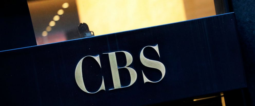FILE - This Thursday, Dec. 6, 2018, file photo shows the CBS logo at the entrance to its headquarters, in New York. CBS is unveiling its fall 2019 prime-time schedule on Wednesday, May 15, 2019, and will host a presentation to advertisers with some o