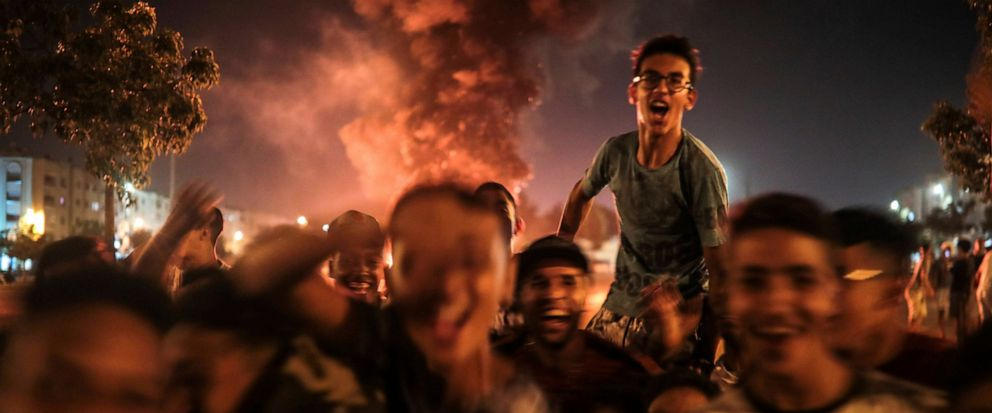 In this Monday, Sept. 9, 2019 photo, youths react during the celebration of Ashura, in Sale, near Rabat, Morocco. On Sept. 9, the Arab and Muslim world marked Ashura, a day commemorating the death of Imam Hussein, the grandson of the Prophet Muhammad