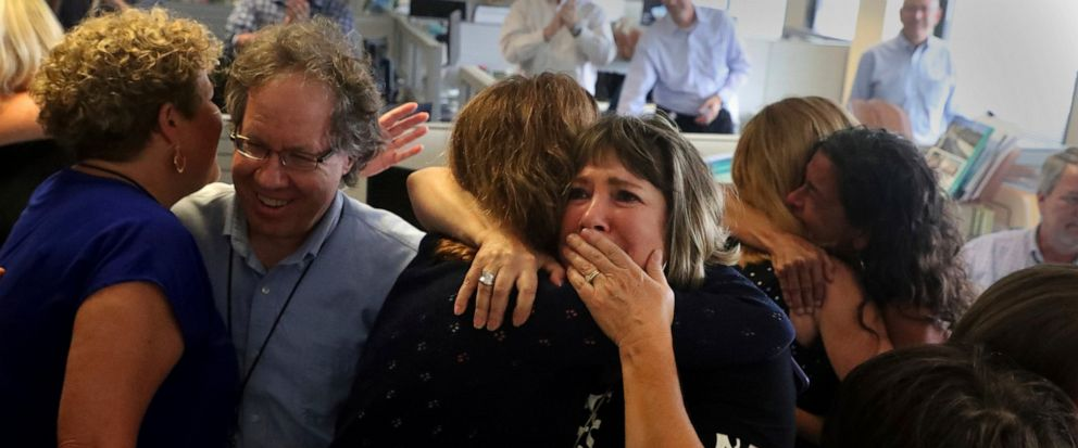 Staff of the South Florida Sun Sentinel celebrate their bittersweet honor Monday, April 15, 2019, in Deerfield Beach, Fla., after winning the Pulitzer Prize for Public Service. The newspaper won for its coverage of the Parkland school shooting. (Carl
