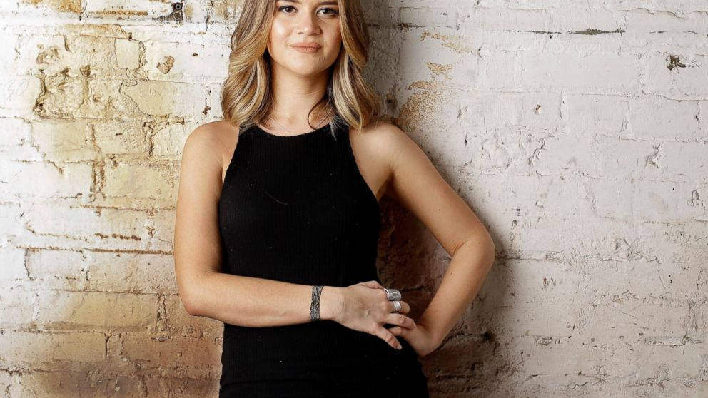 """FILE - In this May 31, 2016, file photo, singer Maren Morris poses in Nashville, Tenn. Morris is nominated in both country, pop and all-genre categories this year, including two nominations in the country genre categories for """"Dear Hate,"""" a duet with Vince Gill released after the Las Vegas mass shooting, and a nomination for """"Mona Lisas and Mad Hatters,"""" a cover from an Elton John tribute album. Her song """"The Middle"""" with EDM artists Zedd and Grey, is nominated for record and song of the year at this year's Grammy Awards on Feb. 10, and Morris was also nominated for best pop duo/group collaboration. (AP Photo/Mark Humphrey, File)"""
