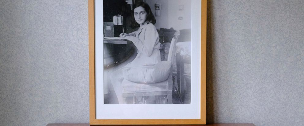 A photo of Anne Frank stands on a replica of the writing desk she once used in her familys former apartment in Amsterdam, during an event to mark what would have been Anne Franks 90th birthday, in Amsterdam, Netherlands, Wednesday, June 12, 2019. O