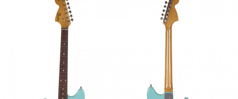 This combination photo of images released by Juliens Auctions shows the front and back of a turquoise-bodied left-handed Fender guitar built in 1993 and used by Nirvana frontman Kurt Cobain during the band's In Utero tour. The item is one of many ro