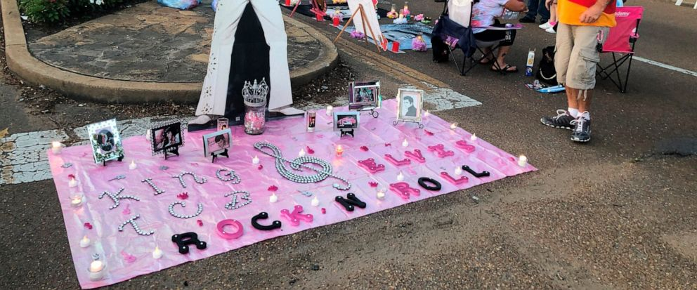 A street art display honoring Elvis Presley is shown at the candlelight vigil at Graceland that commemorates his death 42 years ago on Thursday, Aug. 15, 2019 in Memphis, Tenn. Presley fans flock every year to the Graceland tourist attraction for Elv
