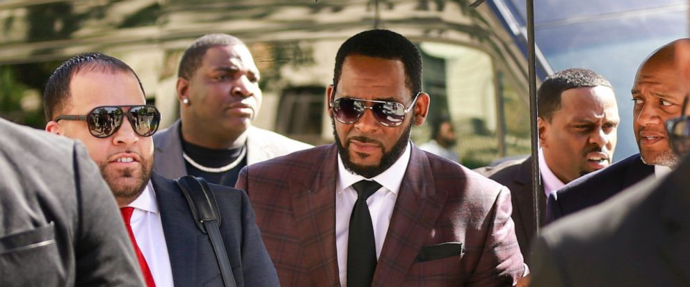 FILE - In this June 26, 2019, file photo, R&B singer R. Kelly, center, arrives at the Leighton Criminal Court building for an arraignment on sex-related felonies in Chicago. R. Kelly, already facing sexual abuse charges brought by Illinois prosecutor