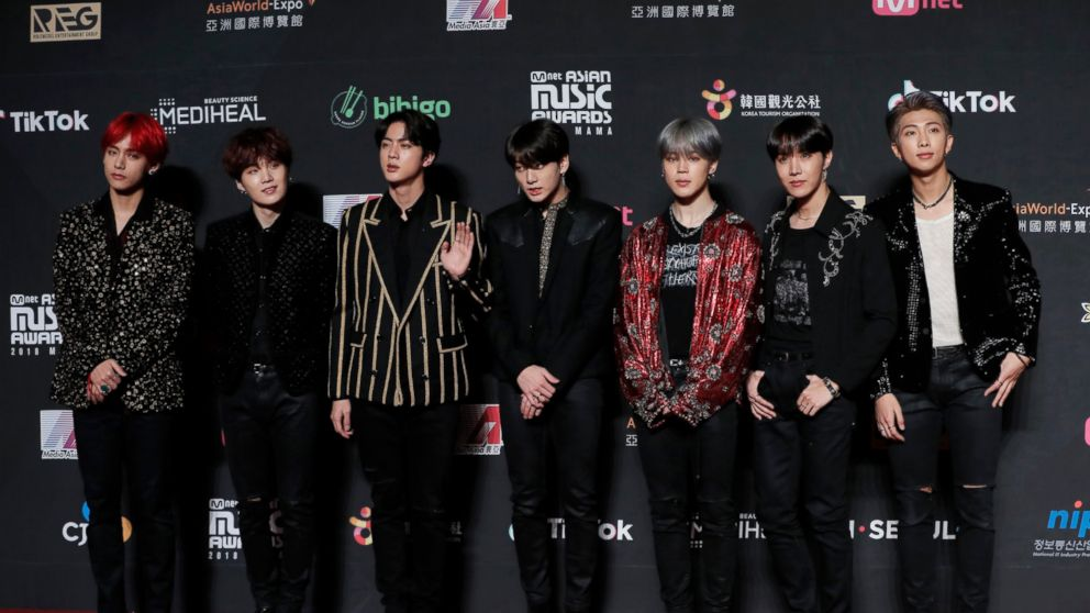FILE- In this Dec. 14, 2018, file photo members of South Korean music band BTS pose for photos on the red carpet of the Mnet Asian Music Awards (MAMA) in Hong Kong. Mattel has signed a licensing deal with BTS. Shares surged more than 8 percent in Monday, Jan. 7, 2019, afternoon trading. (AP Photo/Kin Cheung, File)
