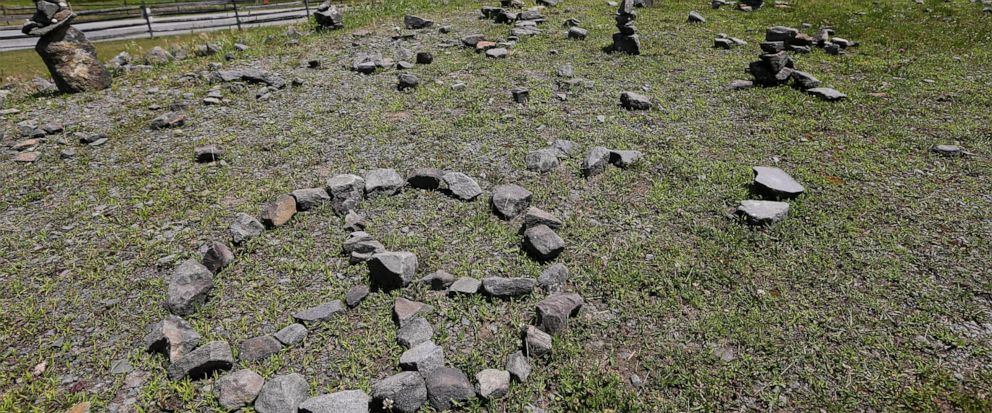 In this Wednesday, July 24, 2019, photo, a flat piece of ground and rock cairns are all that remain of the stage of the 1969 Woodstock Music and Arts Fair in Bethel, N.Y. Woodstock was staged 80 miles (130 kilometers) northwest of New York City on a