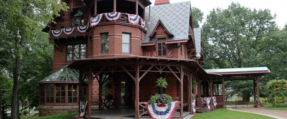 FILE - In this July 14, 2017 file photo, the Mark Twain House sits adorned with red, white and blue bunting in Hartford, Conn. The historic home where Mark Twain and his family once lived has received a $1 million gift from bestselling novelist David