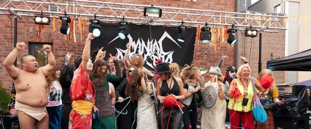 """The competitors of the first Heavy Metal Knitting world championship react on stage, Thursday, July 11, 2019 in Joensuu, Finland. With stage names such as Woolfumes, Bunny Bandit and 9"""" Needles, the goal was quite simple: to showcase their knit"""