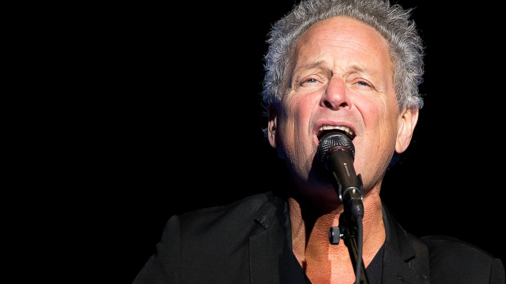 In this Wednesday, Dec. 5, 2018 file photo, Lindsey Buckingham performs at The Wilbur Theatre on in Boston. Buckingham underwent open heart surgery that left the former Fleetwood Mac guitarist with damaged vocal cords. Buckingham's publicist said in a statement Friday, Feb. 8, 2019, that he experienced chest pains last week and was taken to the hospital where he had the life-saving procedure. The 69-year-old rocker's wife, Kristen Buckingham, said on social media that it's unclear if the damage after the surgery is permanent. (Photo by Winslow Townson/Invision/AP, File)