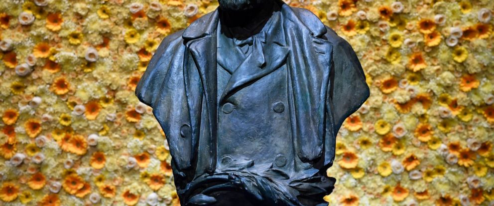 FILE - In this Monday, Dec. 10, 2018 file photo, a bust of the Nobel Prize founder, Alfred Nobel on display at the Concert Hall during the Nobel Prize award ceremony in Stockholm. Controversy stalks the Nobel prizes for peace and literature in a way