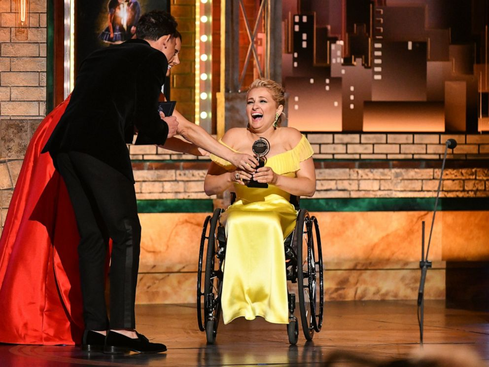 Laura Benanti, from left, and Anthony Ramos present best performance by an actress in a featured role in a musical to Ali Stroker for Rodgers & Hammersteins Oklahoma! at the 73rd annual Tony Awards on Sunday, June 9, 2019, in New York.