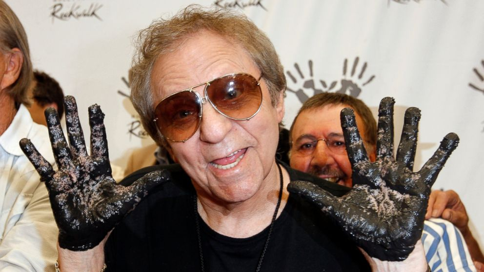 FILE - In this June 25, 2008, file photo, Hal Blaine holds up his hands covered in cement after placing them in wet cement with Don Randi and Glen Campbell, representing The Wrecking Crew following an induction ceremony for Hollywood's RockWalk in Los Angeles. Drummer Blaine, who played on many of the biggest hits in music history, has died. Blaine's son-in-law Andy Johnson tells The Associated Press that Blaine died of natural causes Monday, March 11, 2019, at his home in Palm Desert, California. He was 90. (AP Photo/Kevork Djansezian, File)