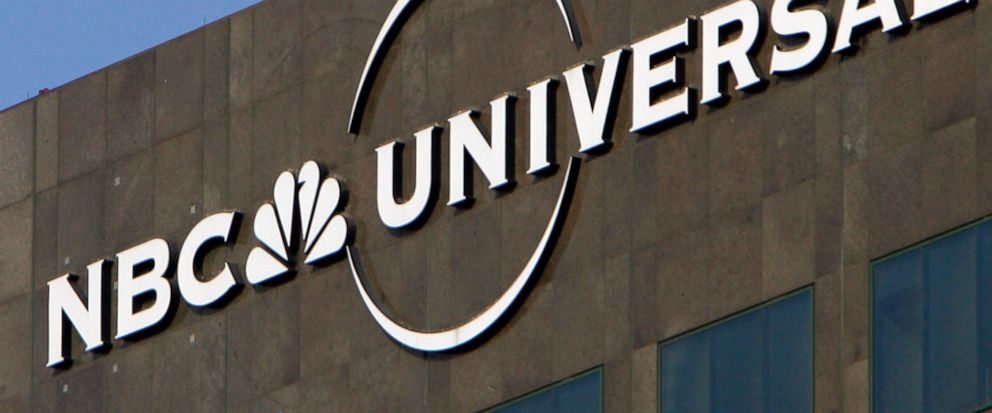 FILE - This Dec. 3, 2009, file photo, the NBC Universal logo hangs on a building in Los Angeles. NBCUniversal announced plans Friday, June 14, 2019, for a state-of-the-art television and film studio in a warehouse district just north of downtown Albu