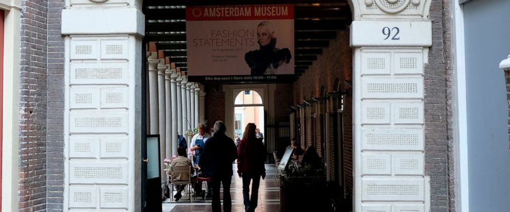 """Visitors enter the Amsterdam Museum in Amsterdam, Friday, Sept. 13, 2019. A museum in Amsterdam is facing criticism for its decision to stop using the term """"Golden Age"""" to describe the 17th century, when the Netherlands was a global mercantile, milit"""