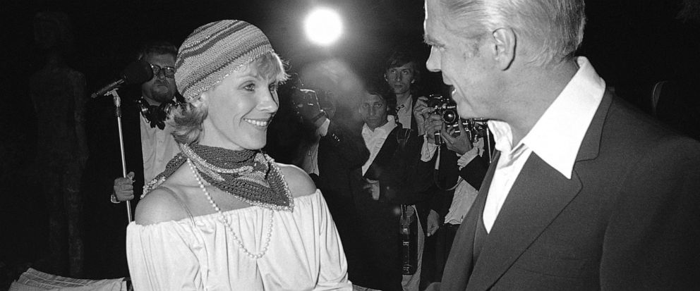 """FILE - In this May 25, 1978 file photo, Swedish actress Bibi Andersson meets George Peppard at a party for the announcement of start of new U.S. film """"Cabo Blanco"""". Sweden's Film Institute says Bibi Andersson, the Swedish actress who played in films"""