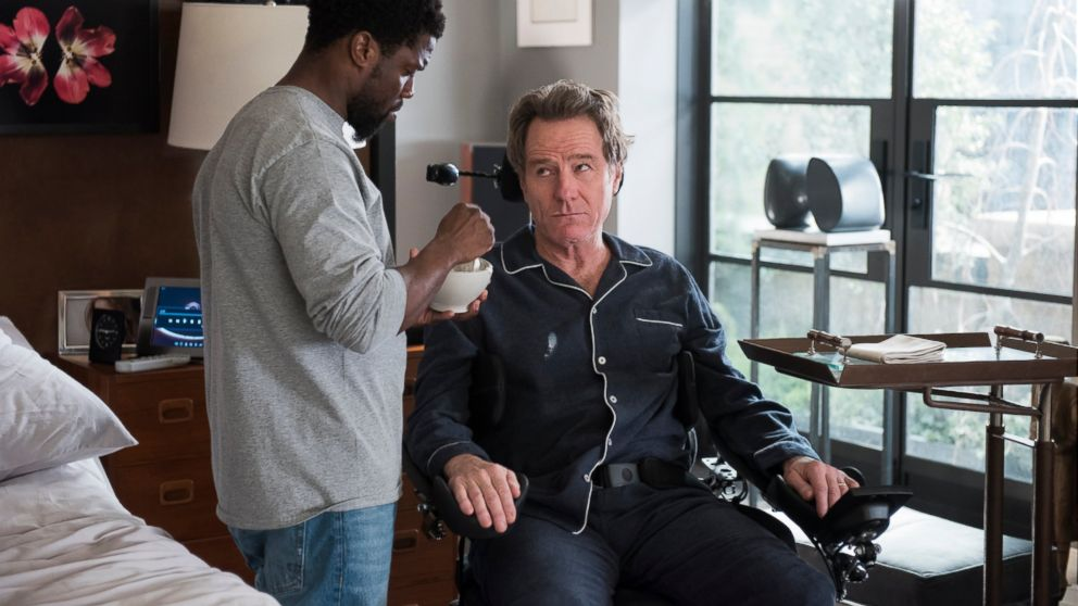 """This image released by STXfilms shows Kevin Hart, left, and Bryan Cranston in a scene from """"The Upside."""" (David Lee/STXfilms via AP)"""