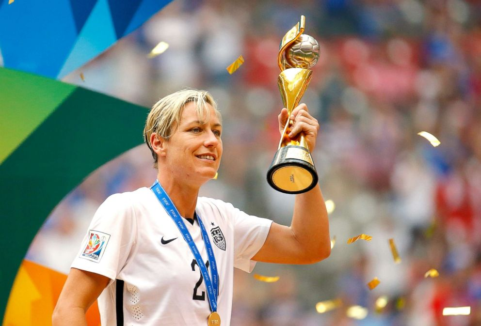 PHOTO: Abby Wambach, no.20, of U.S. holds the World Cup Trophy after their 5-2 over Japan in the FIFA Womens World Cup Canada 2015 Final at BC Place Stadium on July 5, 2015, in Vancouver.
