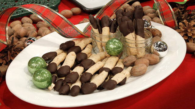 PHOTO:Chocolate-Dipped Pecan Shortbread Logs are shown here.